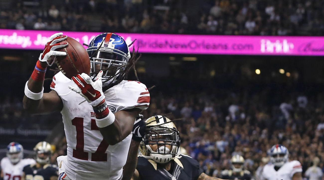 New York Giants wide receiver Dwayne Harris (17) pulls in a touchdown reception in front of New Orleans Saints defensive back Kyle Wilson (24) in the second half of an NFL football game against the New Orleans Saints in New Orleans, Sunday, Nov. 1, 2015.