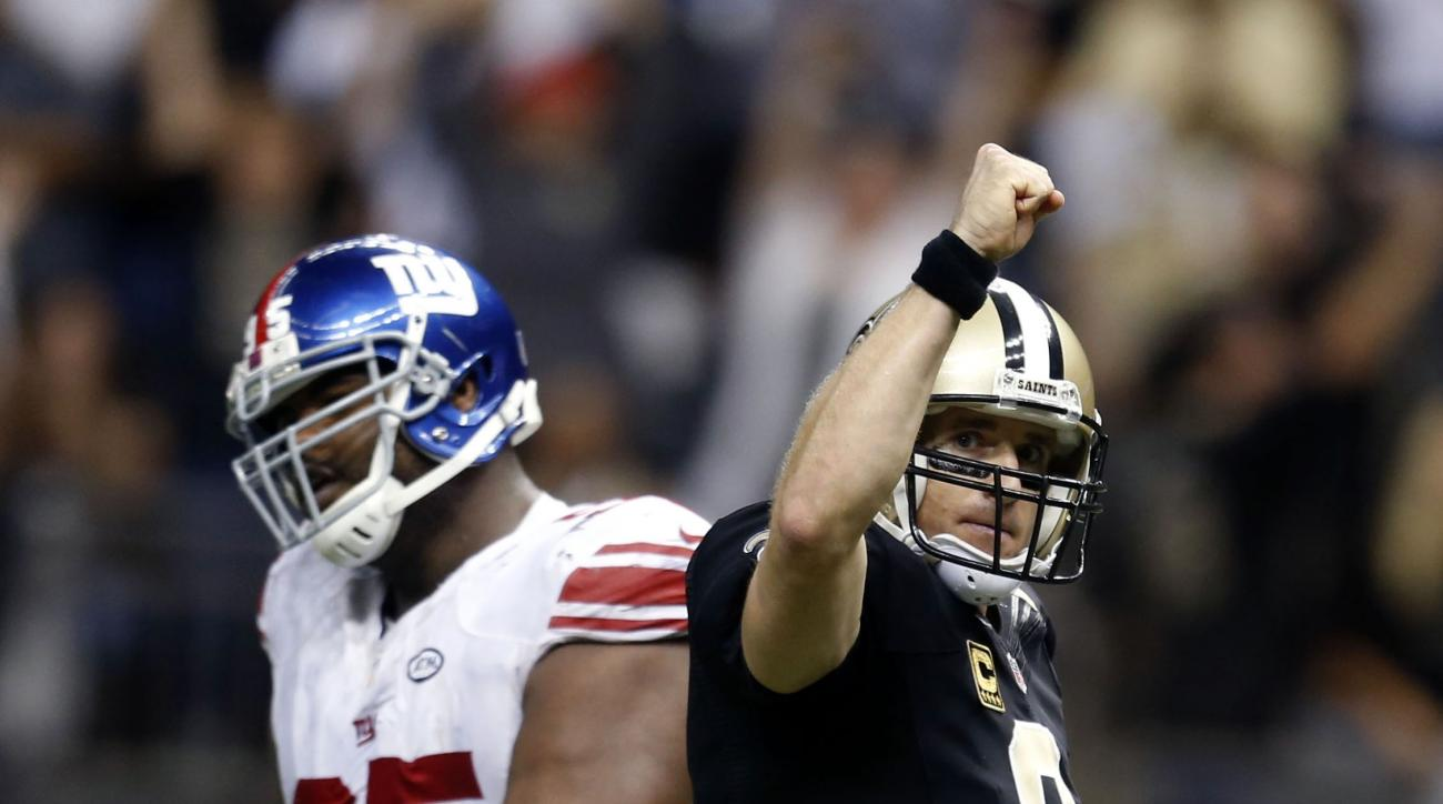 New Orleans Saints quarterback Drew Brees (9) reacts after throwing a touchdown pass to tie the game late in the second half of an NFL football game in New Orleans, Sunday, Nov. 1, 2015. The pass tied the record for most touchdown passes thrown in a game