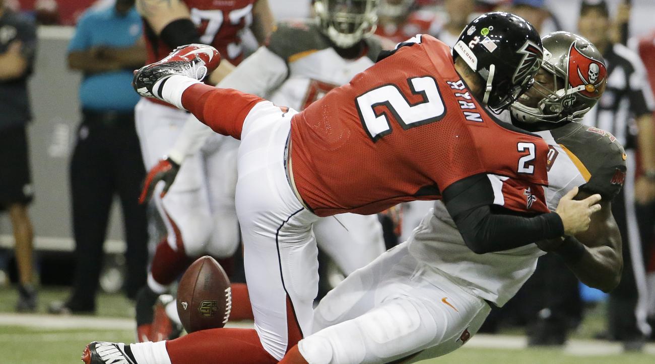 Tampa Bay Buccaneers defensive end Howard Jones (95) pulls at Atlanta Falcons quarterback Matt Ryan (2) causing a fumble during overtime of an NFL football game, Sunday, Nov. 1, 2015, in Atlanta. The Tampa Bay Buccaneers won 23-20. (AP Photo/David Goldman