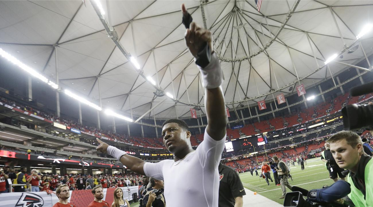 Tampa Bay Buccaneers quarterback Jameis Winston walks off the field after overtime of an NFL football game against the Atlanta Falcons, Sunday, Nov. 1, 2015, in Atlanta. The Tampa Bay Buccaneers won 23-20. (AP Photo/David Goldman)