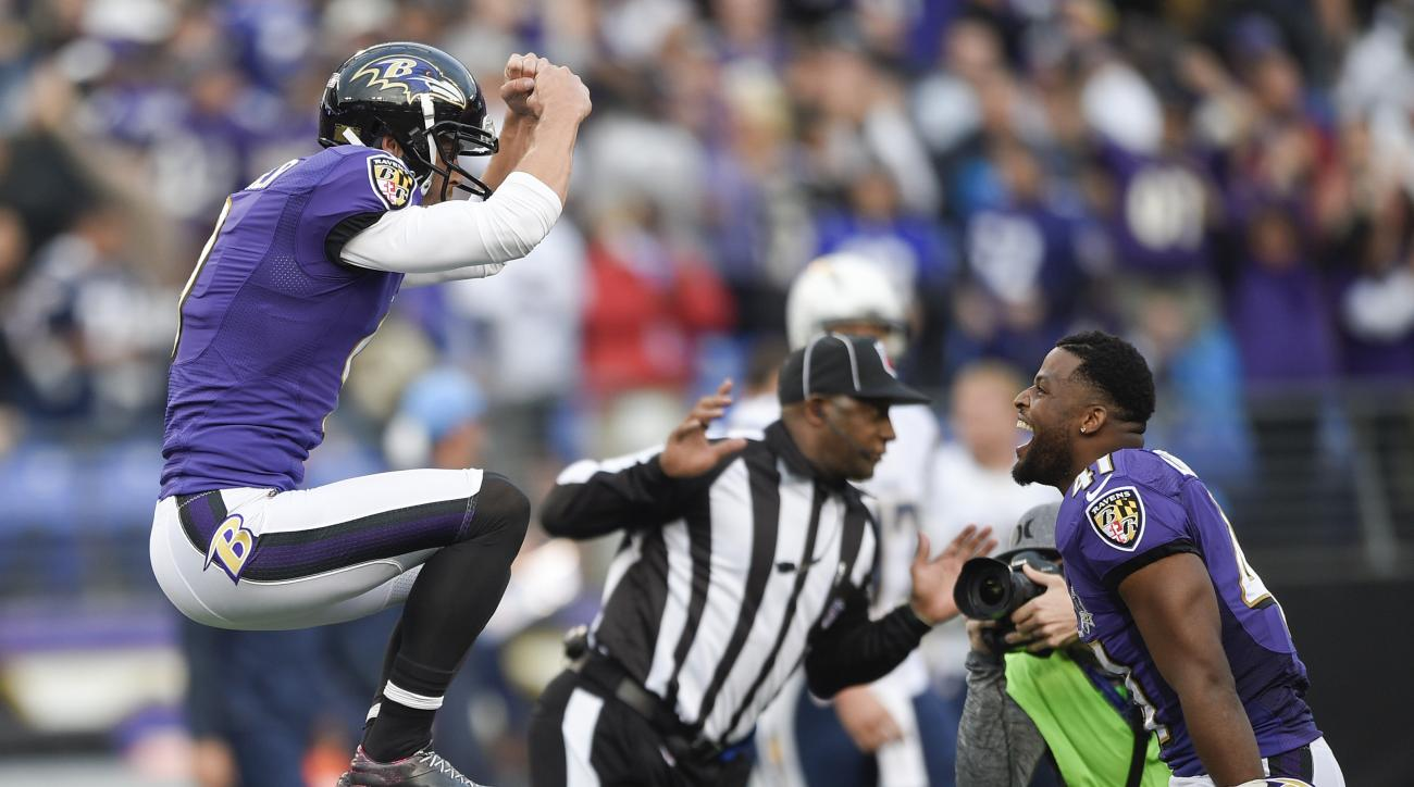 Baltimore Ravens kicker Justin Tucker (9) celebrates his game winning field goal with teammate cornerback Anthony Levine (41) during the second half of an NFL football game against the San Diego Chargers in Baltimore, Sunday, Nov. 1, 2015. The Ravens defe