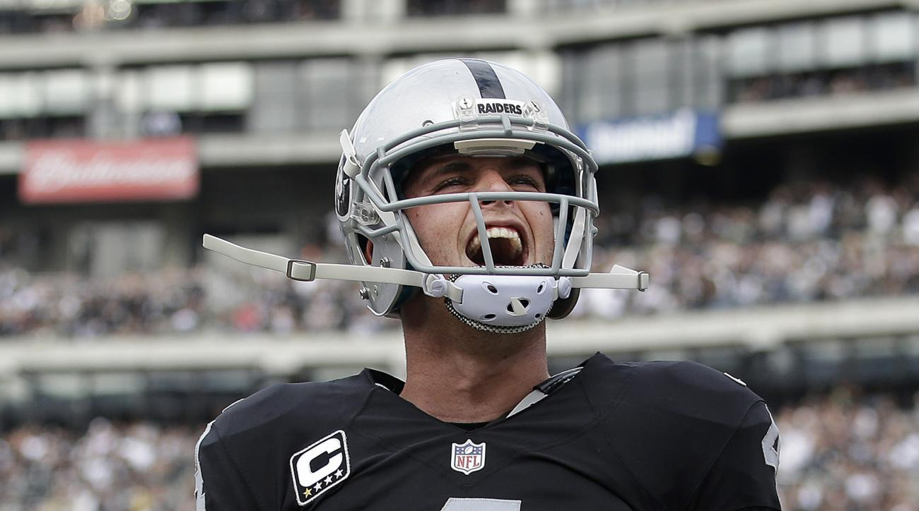 Oakland Raiders quarterback Derek Carr reacts after throwing a touchdown pass to wide receiver Andre Holmes during the first half of an NFL football game against the New York Jets in Oakland, Calif., Sunday, Nov. 1, 2015. (AP Photo/Marcio Jose Sanchez)