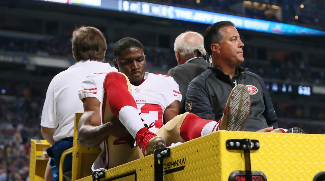 San Francisco 49ers running back Reggie Bush is carted off the field after being injured during an NFL football game against the St. Louis Rams, Sunday, Nov. 1, 2015, in St. Louis. (Chris Lee/St. Louis Post-Dispatch via AP)  EDWARDSVILLE INTELLIGENCER OUT