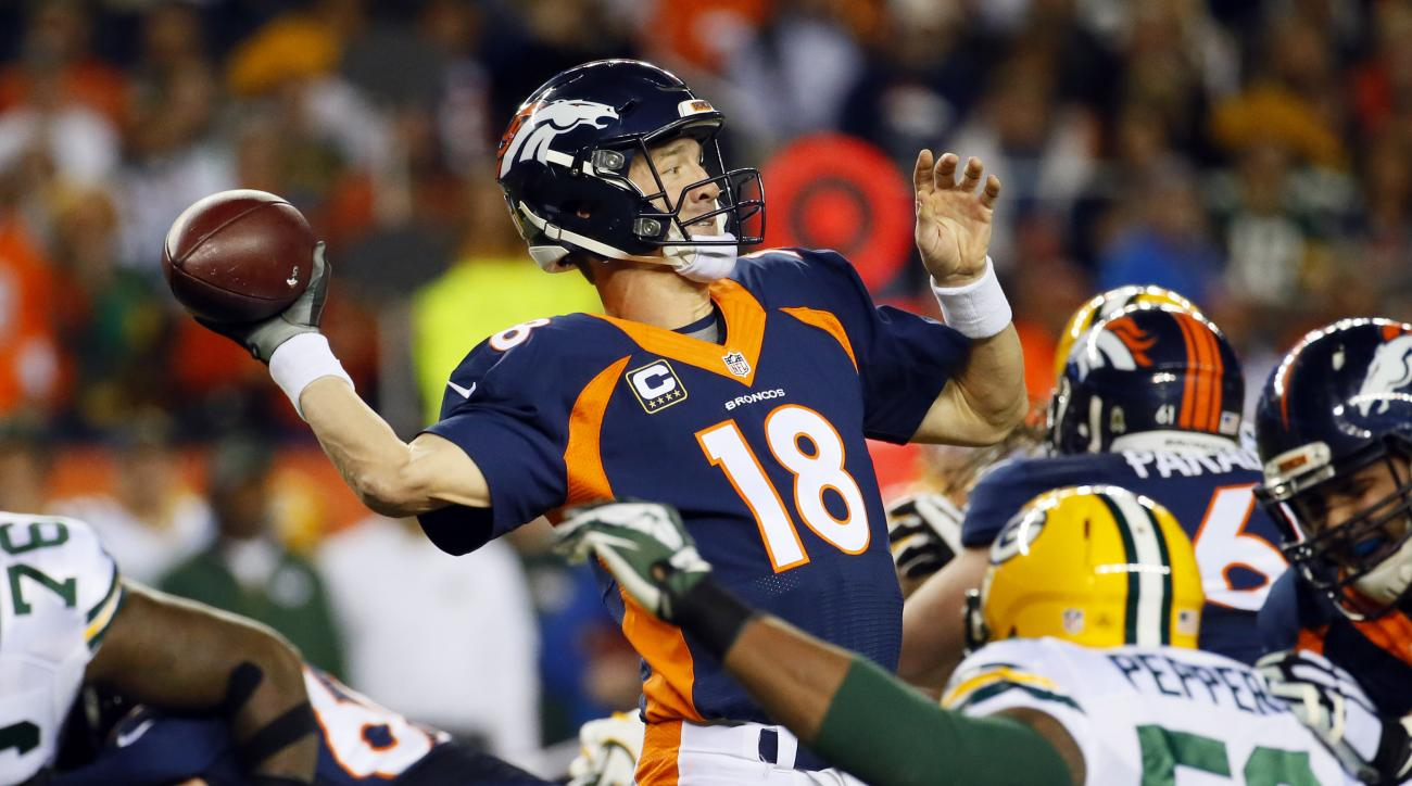 Denver Broncos quarterback Peyton Manning (18) throws against the Green Bay Packers during the first half of an NFL football game, Sunday, Nov. 1, 2015, in Denver. (AP Photo/Jack Dempsey)
