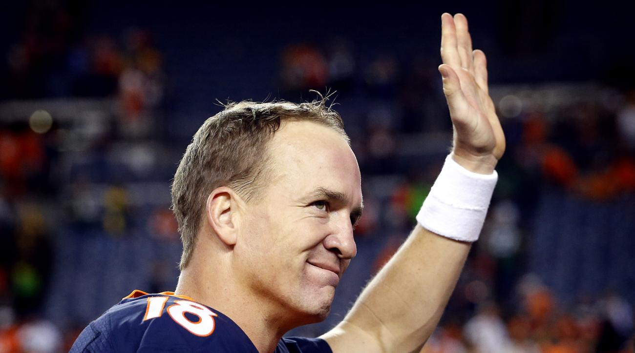 Denver Broncos quarterback Peyton Manning (18) waves after an NFL football game against the Green Bay Packers, Sunday, Nov. 1, 2015, in Denver. With the win, Manning tied Brett Favre with the most wins in NFL history by a starting quarterback with 186. Th