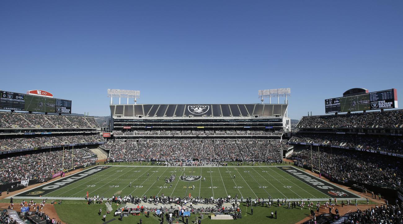 FILE - This Oct. 11, 2015, file photo shows an overall of O.co Coliseum during an NFL game between the Oakland Raiders and Denver Broncos, in Oakland, Calif. Oakland city officials are taking yet another run at financing a new stadium to keep the Oakland