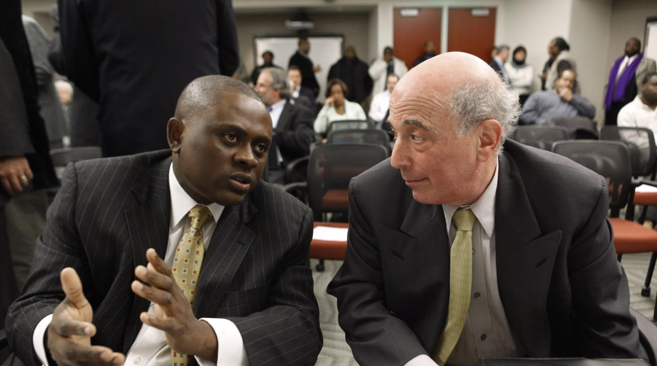FILE - In this Jan. 4, 2010, file photo, Dr. Bennet Omalu, left, Co-Director, Brain Injury Research Institute, West Virginia University,  talks with Dr. Ira R. Casson, Neurologist and former co-chairman, NFL Mild Traumatic Brain Injury Committee, before a