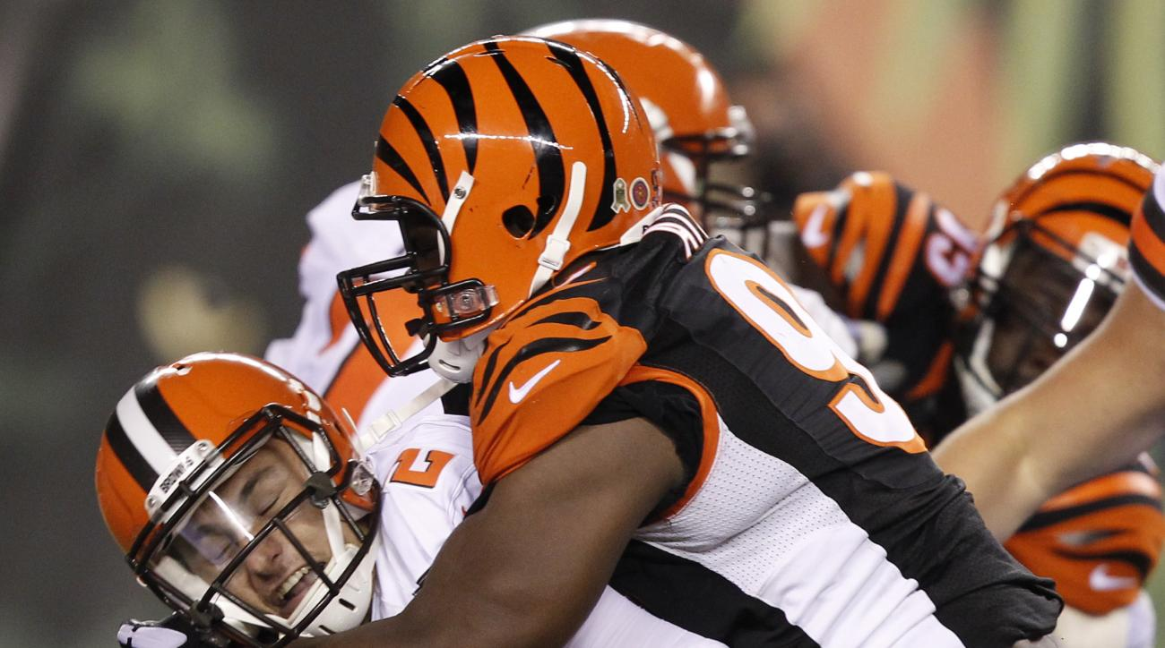 Cleveland Browns quarterback Johnny Manziel (2) is sacked by Cincinnati Bengals defensive tackle Geno Atkins (97) druing the second half of an NFL football game, Thursday, Nov. 5, 2015, in Cincinnati. (AP Photo/Frank Victores)