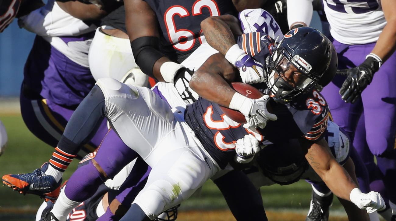 FILE - In this Nov. 1, 2015, file photo, Chicago Bears rookie running back Jeremy Langford (33) is tackled by Minnesota Vikings cornerback Captain Munnerlyn (24) during an NFL football game in Chicago. With star running back Matt Forte expected to be out