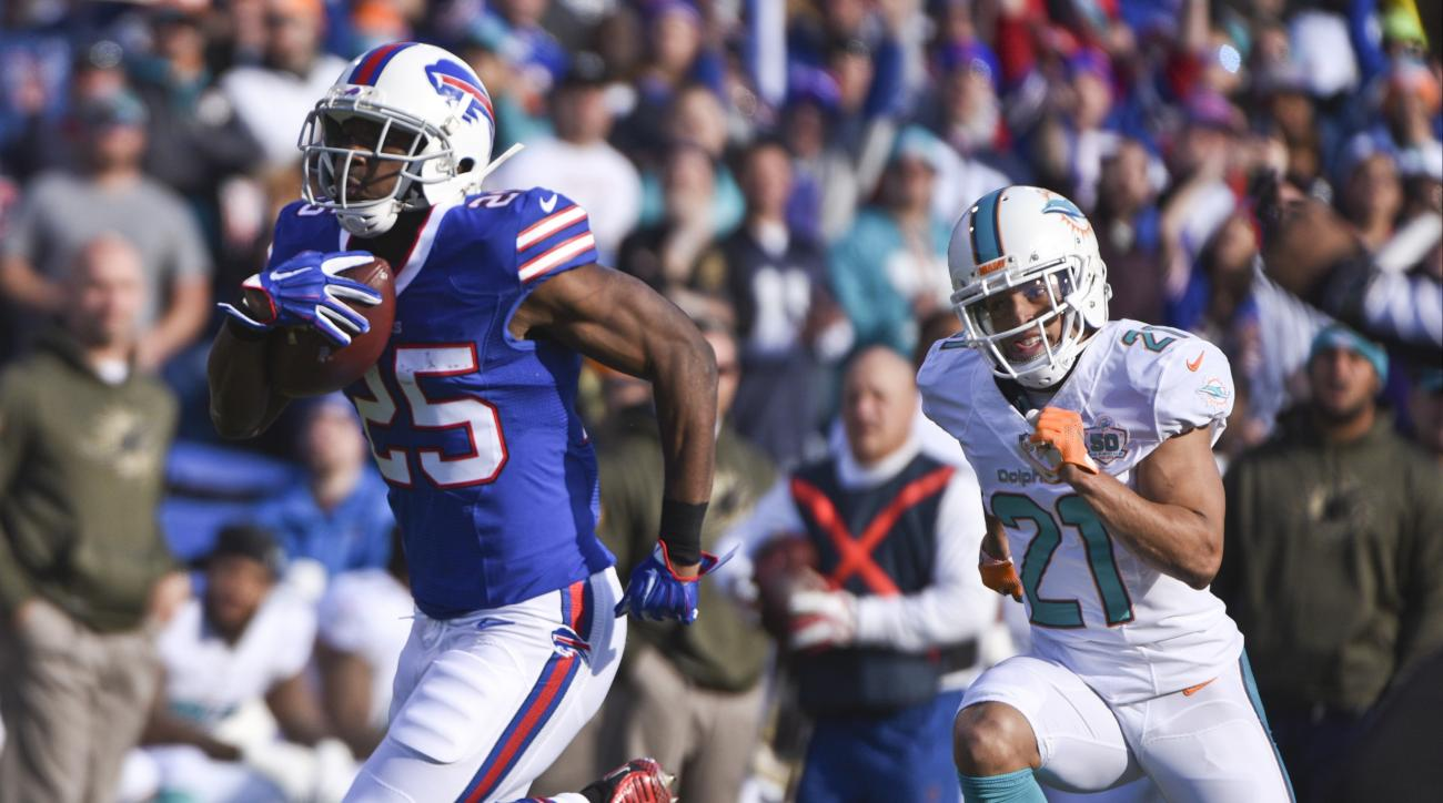 Buffalo Bills running back LeSean McCoy (25) runs away from Miami Dolphins' Brent Grimes (21) for a touchdown during the first half of an NFL football game Sunday, Nov. 8, 2015, in Orchard Park, N.Y. (AP Photo/Gary Wiepert)