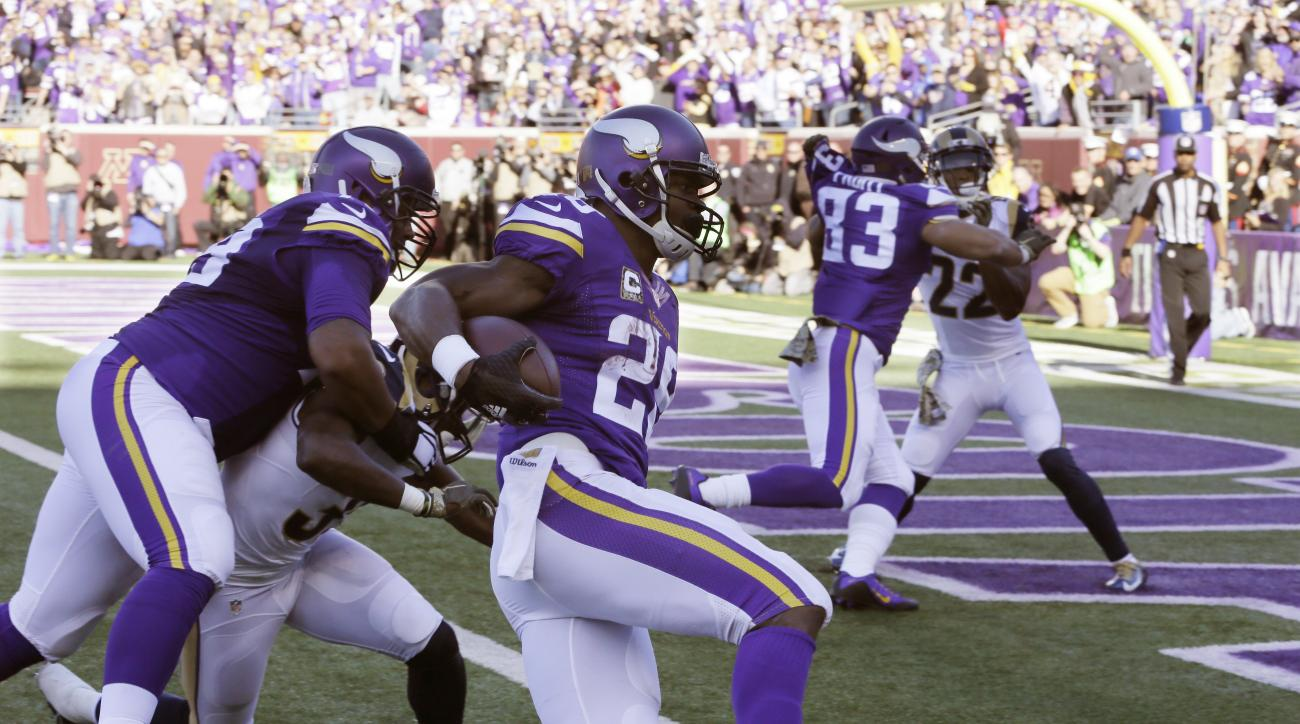 Minnesota Vikings running back Adrian Peterson (28) gets into the end zone with a 6-yard run for a touchdown during the first half of an NFL football game against the St. Louis Rams, Sunday, Nov. 8, 2015, in Minneapolis. (AP Photo/Jim Mone)