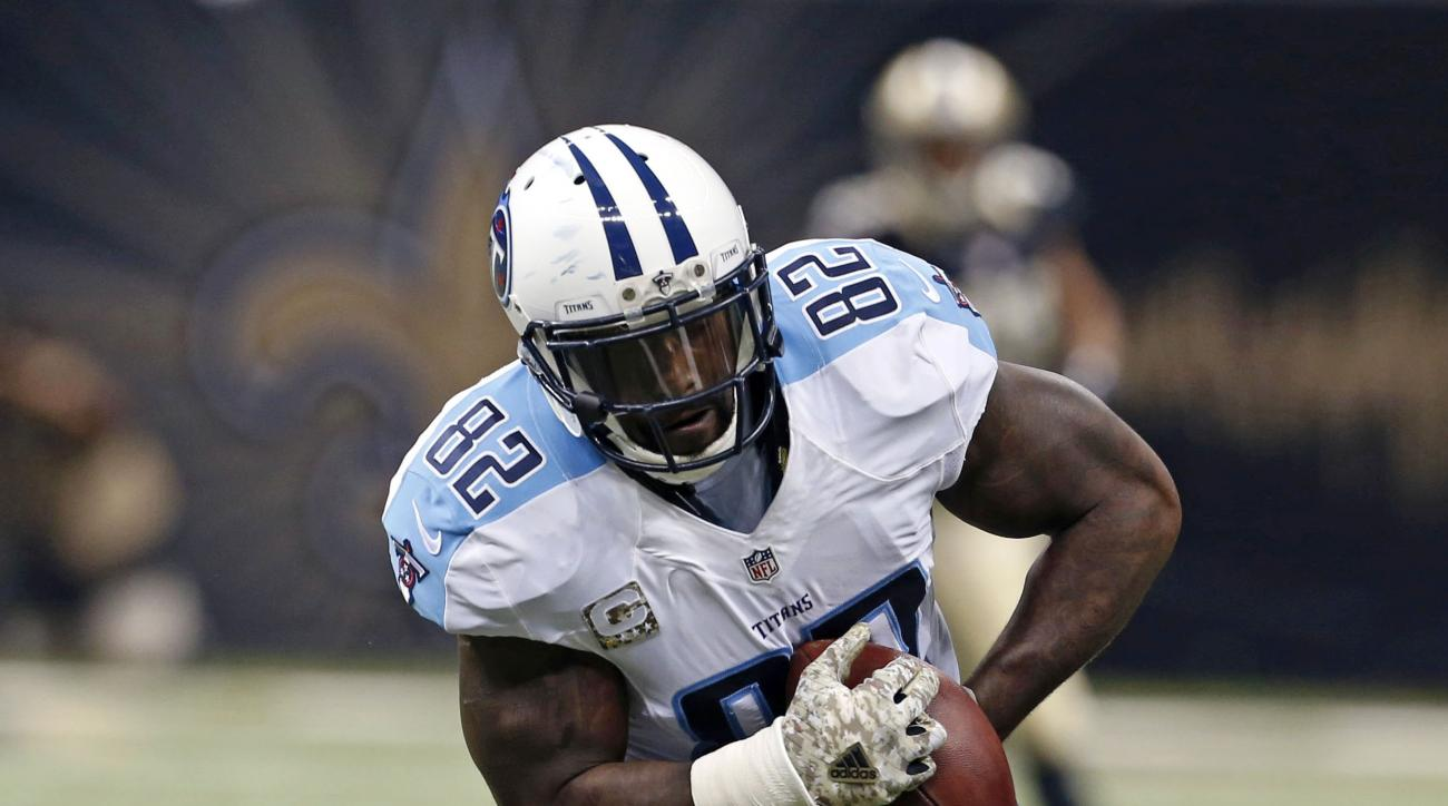 Tennessee Titans tight end Delanie Walker (82) pulls the ball out of the hands of New Orleans Saints free safety Jairus Byrd (31) on a touchdown reception in the first half of an NFL football game in New Orleans, Sunday, Nov. 8, 2015. (AP Photo/Jonathan B