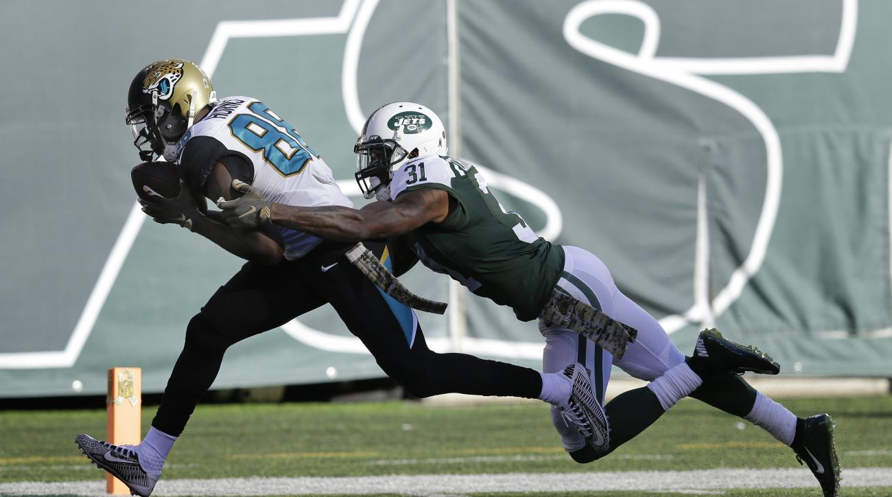 Jacksonville Jaguars wide receiver Allen Hurns (88) crosses the goal line for a touchdown against New York Jets cornerback Antonio Cromartie (31) during the second quarter of an NFL football game, Sunday, Nov. 8, 2015, in East Rutherford, N.J. (AP Photo/S