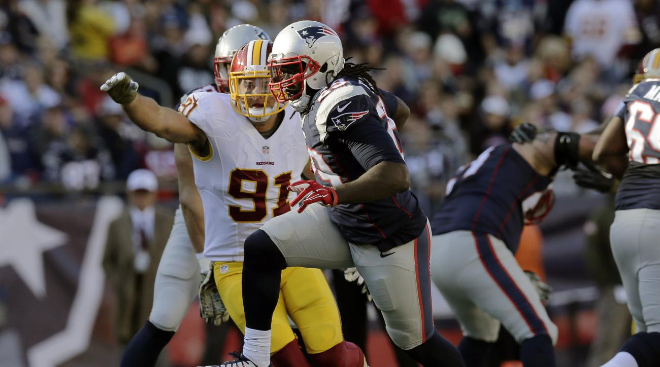 New England Patriots running back LeGarrette Blount (29) runs away from Washington Redskins linebacker Ryan Kerrigan (91) during the first half of an NFL football game, Sunday, Nov. 8, 2015, in Foxborough, Mass. (AP Photo/Charles Krupa)