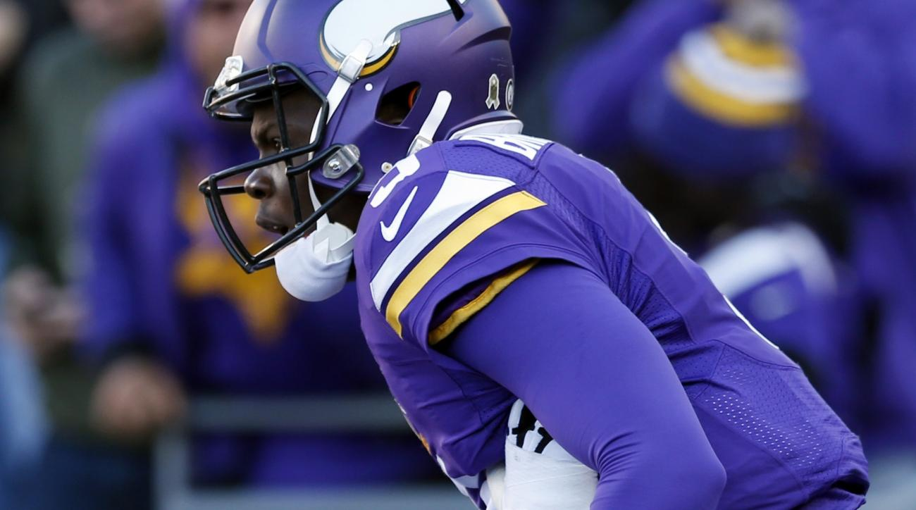Minnesota Vikings quarterback Teddy Bridgewater is lifted by Brandon Fusco after Bridgewater scored on a run during the second half of an NFL football game against the St. Louis Rams, Sunday, Nov. 8, 2015, in Minneapolis. (AP Photo/Jim Mone)