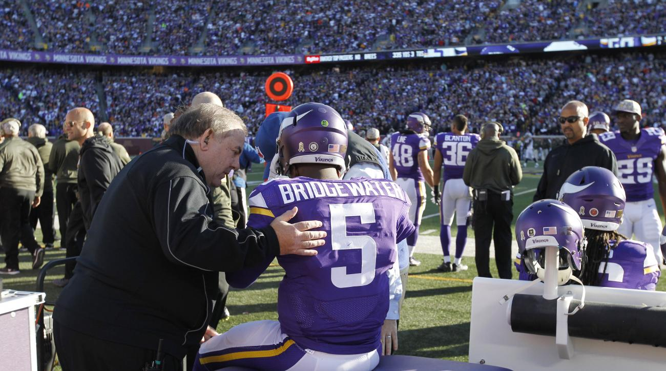 Minnesota Vikings quarterback Teddy Bridgewater (5) is examined during the second half of an NFL football game against the St. Louis Rams, Sunday, Nov. 8, 2015, in Minneapolis. (AP Photo/Ann Heisenfelt)