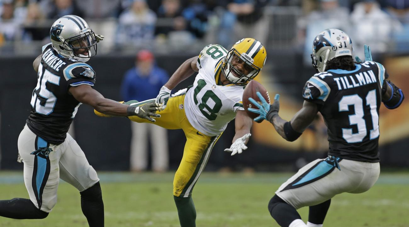 Green Bay Packers' Randall Cobb (18) misses a catch as Carolina Panthers' Charles Tillman (31) and Bene' Benwikere (25) defend in the second half of an NFL football game in Charlotte, N.C., Sunday, Nov. 8, 2015. (AP Photo/Bob Leverone)