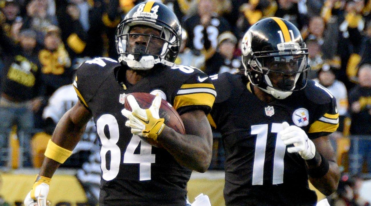 Pittsburgh Steelers wide receiver Antonio Brown (84) runs with Markus Wheaton ahead of Oakland Raiders defenders after making a catch to help set up the Steelers game winning field goal in the fourth quarter of an NFL football game against the Oakland Rai