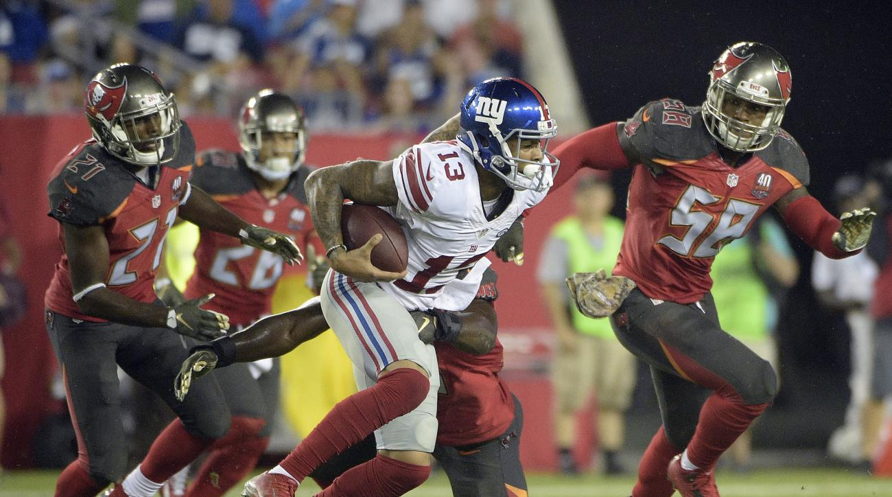 New York Giants wide receiver Odell Beckham (13) runs with a reception against Tampa Bay Buccaneers defenders, including Kwon Alexander (58) and cornerback Alterraun Verner (21) during the fourth quarter of an NFL football game Sunday, Nov. 8, 2015, in Ta