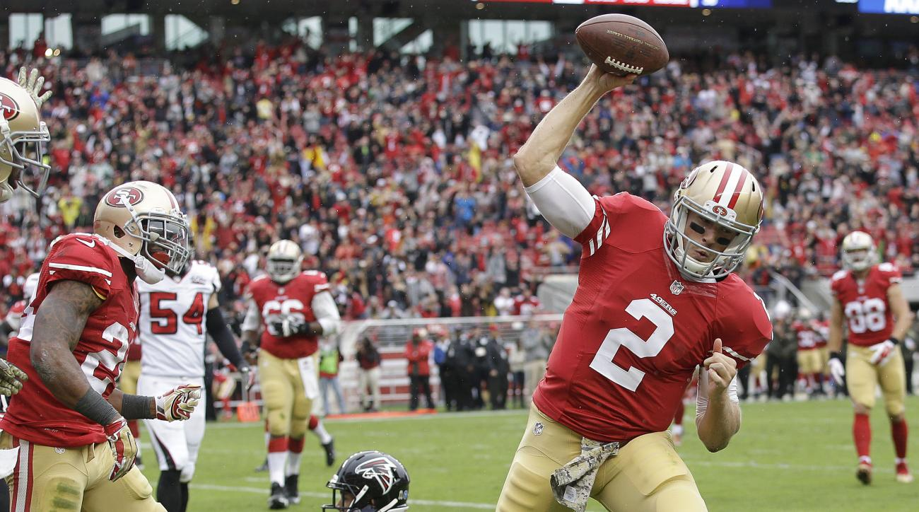 San Francisco 49ers quarterback Blaine Gabbert (2) spikes the ball after running to the 1-yard line against the Atlanta Falcons during the first half of an NFL football game in Santa Clara, Calif., Sunday, Nov. 8, 2015. The 49ers won 17-16. (AP Photo/Marc