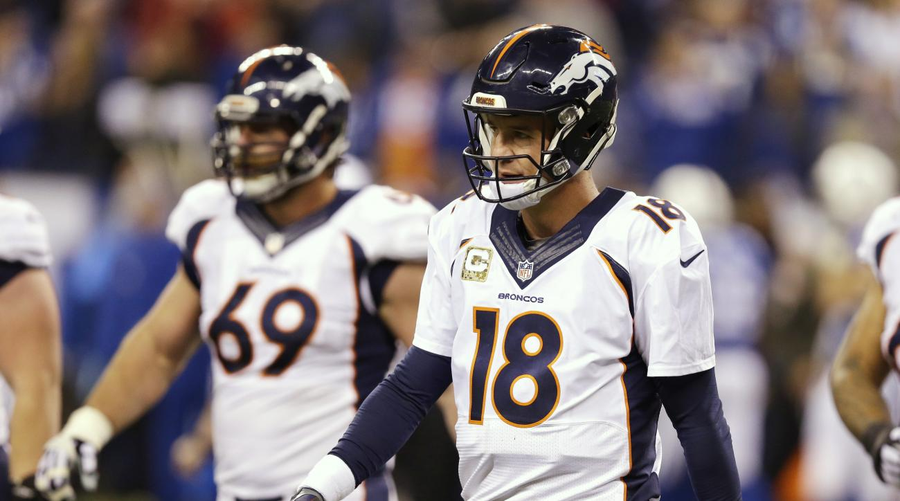 Denver Broncos quarterback Peyton Manning (18) walks off the field after throwing an interception during the second half of an NFL football game against the Indianapolis Colts, Sunday, Nov. 8, 2015, Indianapolis. The Colts won 27-24. (AP Photo/Michael Con