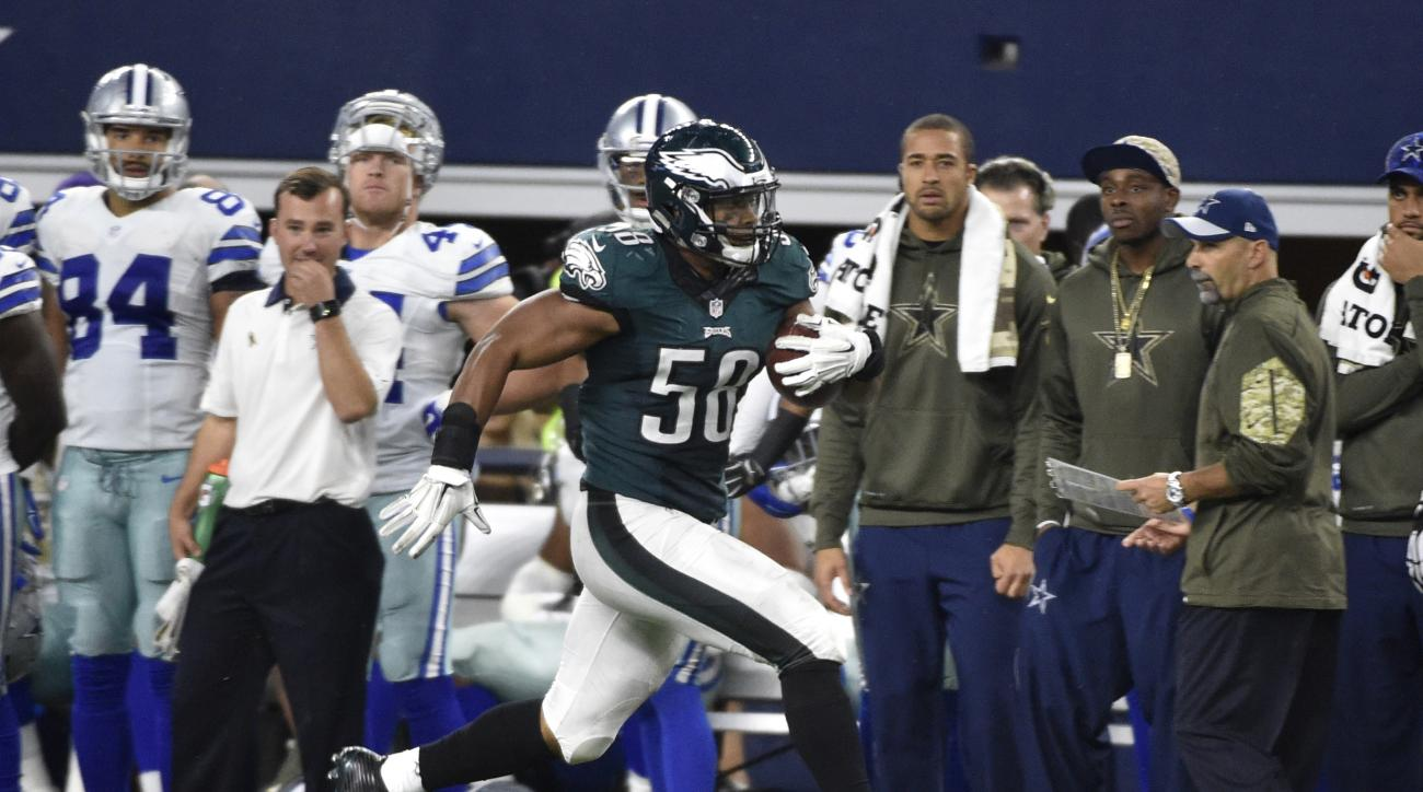Philadelphia Eagles' Jordan Hicks (58) runs back an interception from the Dallas Cowboys for a touchdown in the second half of an NFL football game, Sunday, Nov. 8, 2015, in Arlington, Texas. (AP Photo/Michael Ainsworth)