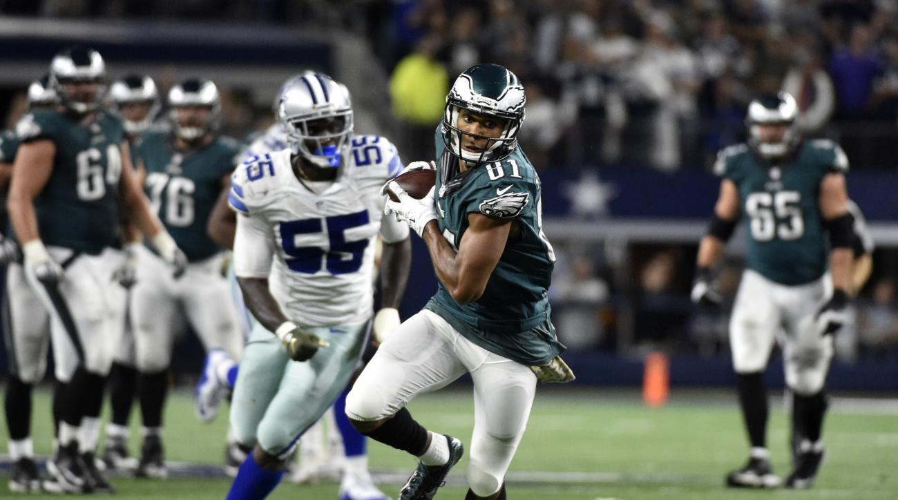Philadelphia Eagles' Jordan Matthews (81) catches a pass and runs it to the end zone for a touchdown as Dallas Cowboys' Rolando McClain (55) watches in overtime of an NFL football game Sunday, Nov. 8, 2015, in Arlington, Texas. The Eagles won 33-27. (AP P