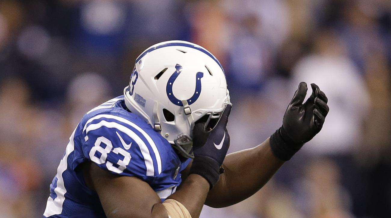 Indianapolis Colts' Dwayne Allen (83) reacts after getting poked in the eye by Denver Broncos' Aqib Talib during the second half of an NFL football game Sunday, Nov. 8, 2015, Indianapolis. Aqib Talib turned Denver's dominant defense into a Three Stooges r