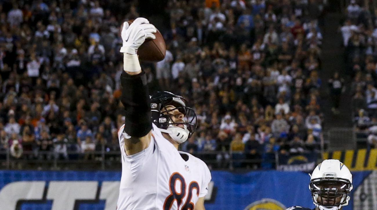 Chicago Bears tight end Zach Miller makes a touchdown catch as San Diego Chargers inside linebacker Donald Butler looks on during the second half of an NFL football game Monday, Nov. 9, 2015, in San Diego. (AP Photo/Lenny Ignelzi)