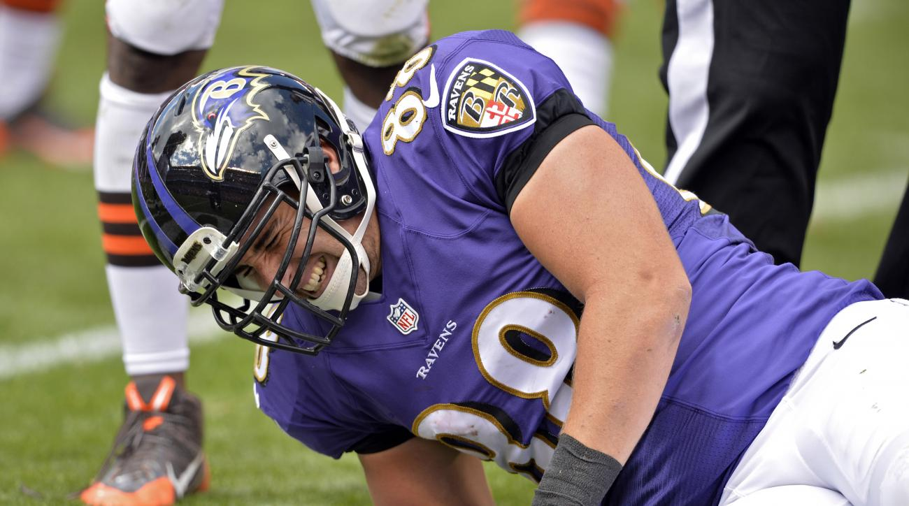 FILE - In this Sept. 21, 2014, file photo, Baltimore Ravens tight end Dennis Pitta reacts after an injury in the second quarter of an NFL football game against the Cleveland Browns, in Cleveland. Pitta will be placed on injured reserve after doctors advis