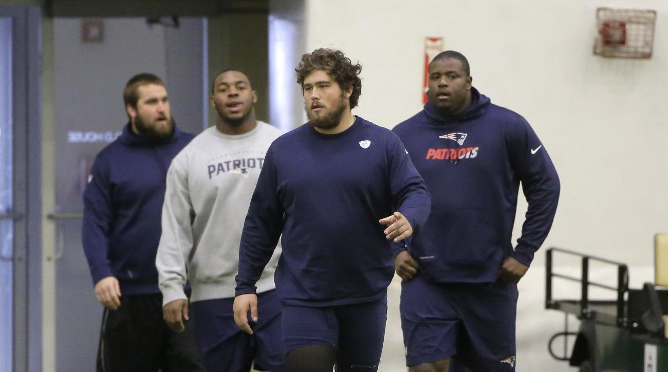 New England Patriots offensive linemen, front left, Josh Kline, Shaq Mason, David Andrews, and Cameron Fleming walk onto the field at the start of an NFL football practice, Wednesday, Nov. 11, 2015, in Foxborough, Mass. The Patriots are to play the New Yo