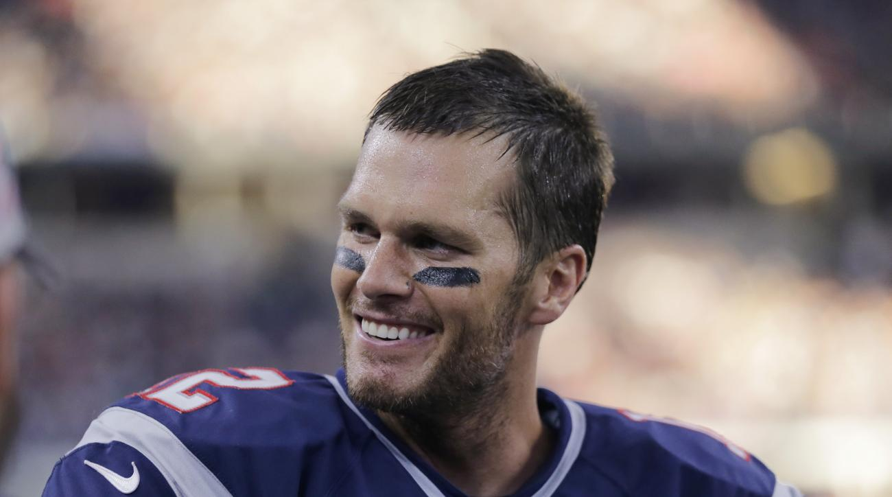 FILE - In this Oct. 11, 2015, file photo, New England Patriots quarterback Tom Brady smiles on the sideline during the second half of an NFL football game against the Dallas Cowboys in Arlington, Texas. The last time Brady and Co. were 8-0 was in 2007, an