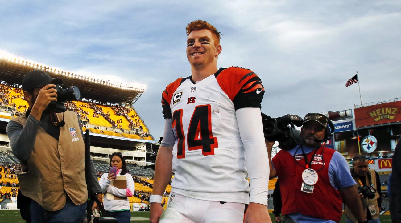 FILE - In this Nov. 1, 2015, file photo, Cincinnati Bengals quarterback Andy Dalton walks off the field after the team's 16-10 win over the Pittsburgh Steelers in an NFL football game in Pittsburgh. Adding some spice to a Week 11 game between two strong t