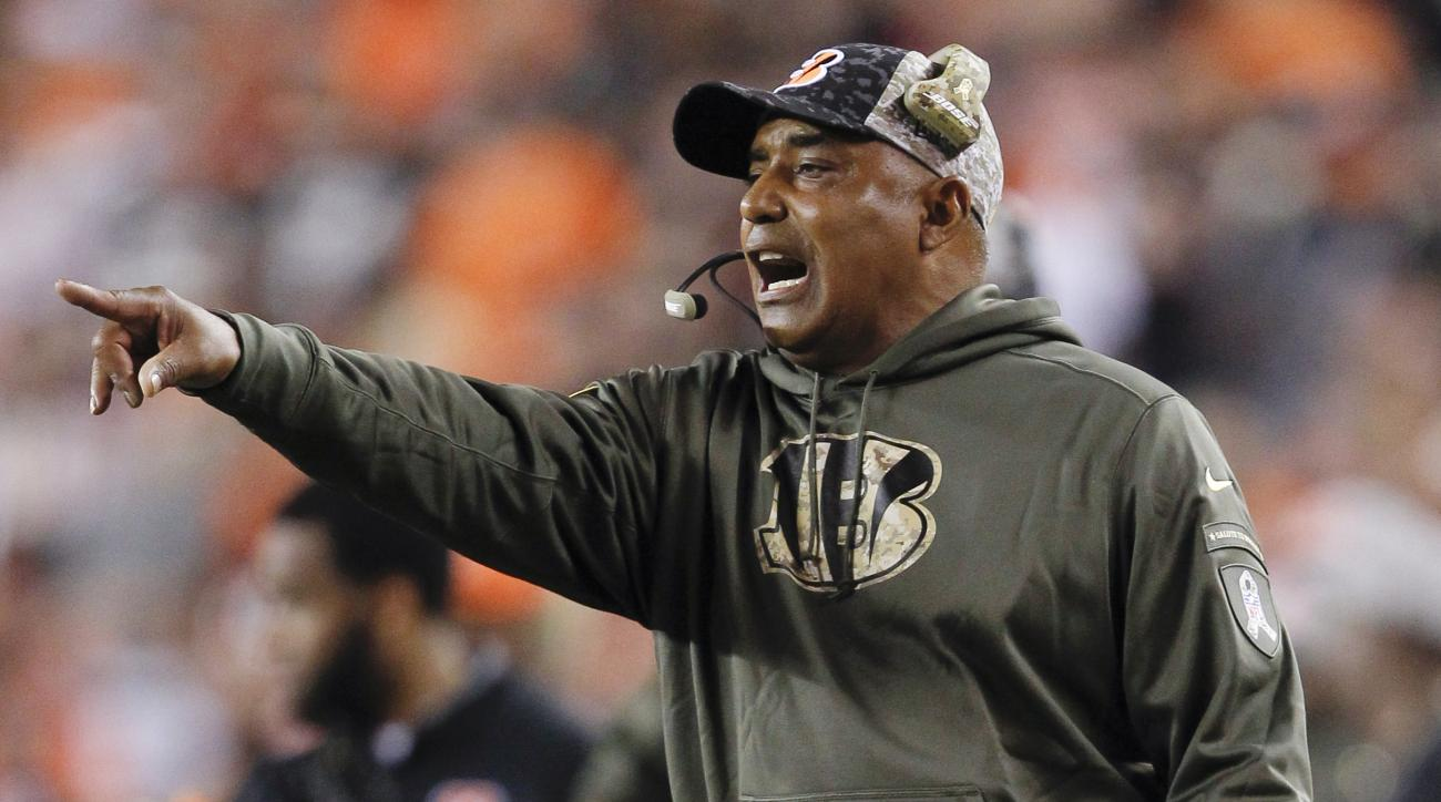 FILE - In this Nov. 5, 2015, file photo, Cincinnati Bengals coach Marvin Lewis gestures from the sideline during the first half of the Bengals' NFL football game against the Cleveland Browns,  in Cincinnati. The Associated Press will announce its 2015 NFL