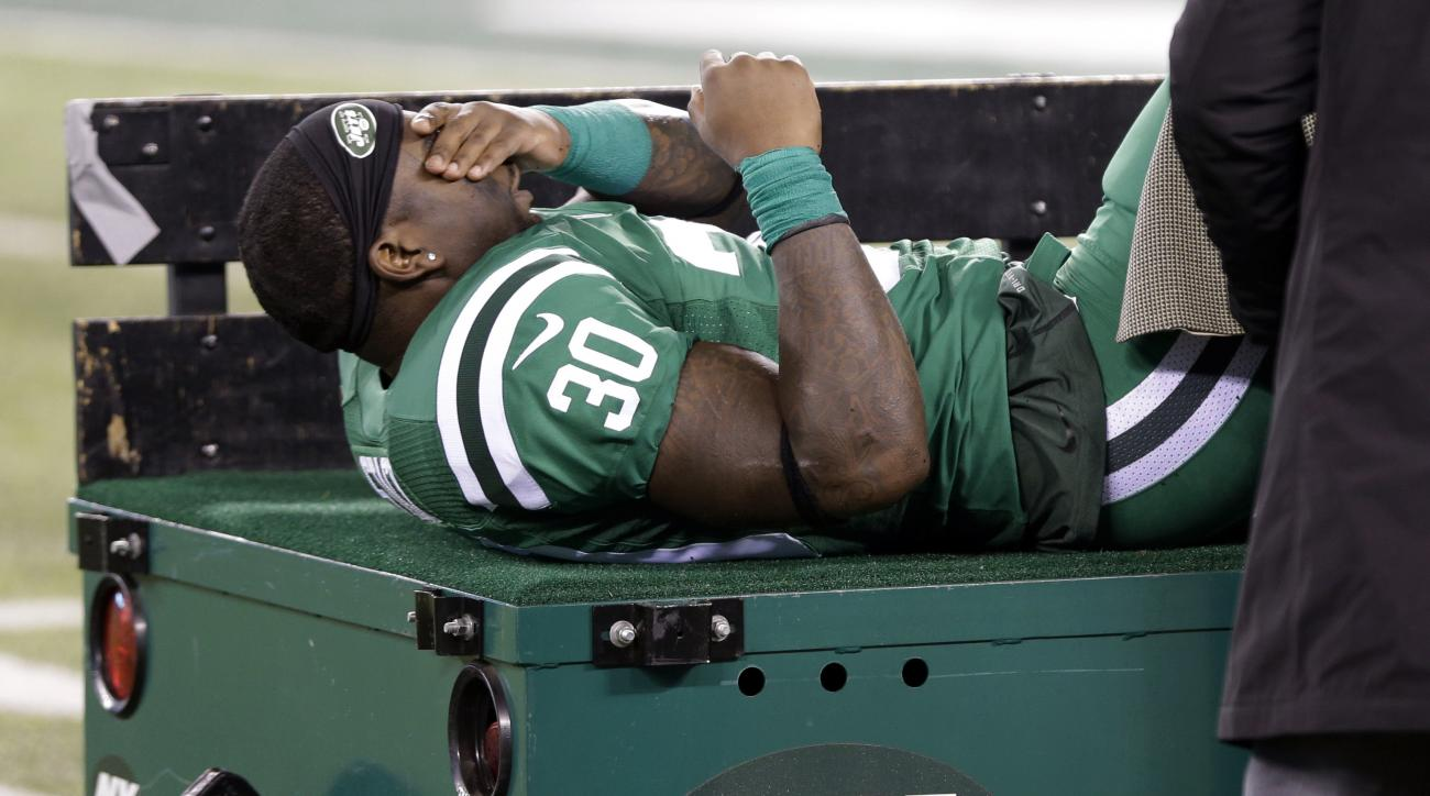 New York Jets running back Zac Stacy reacts as he is treated by trainers before being carted off the field during the first half of an NFL football game against the Buffalo Bills, Thursday, Nov. 12, 2015, in East Rutherford, N.J. (AP Photo/Seth Wenig)