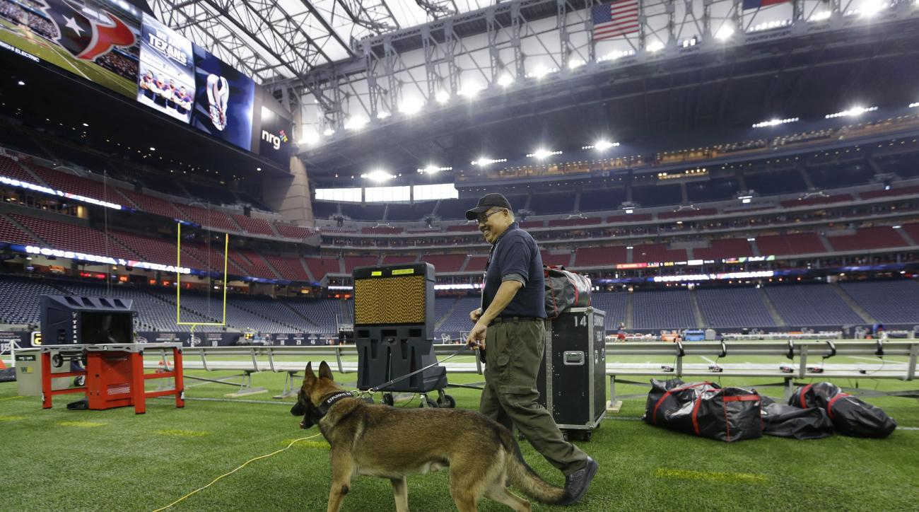 A security dog is used at NRG Stadium before an NFL football game between the Houston Texans and Tampa Bay Buccaneers, Sunday, Sept. 27, 2015, in Houston. (AP Photo/David J. Phillip)