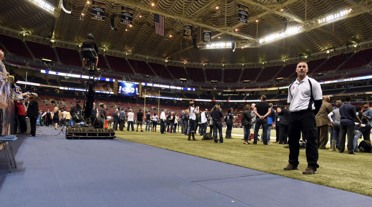 New slip resistant surface is seen just off the turf field inside the Edward Jones Dome before the start of an NFL football game between the St. Louis Rams and the Chicago Bears, Sunday, Nov. 15, 2015, in St. Louis. The surface has been added after San Fr