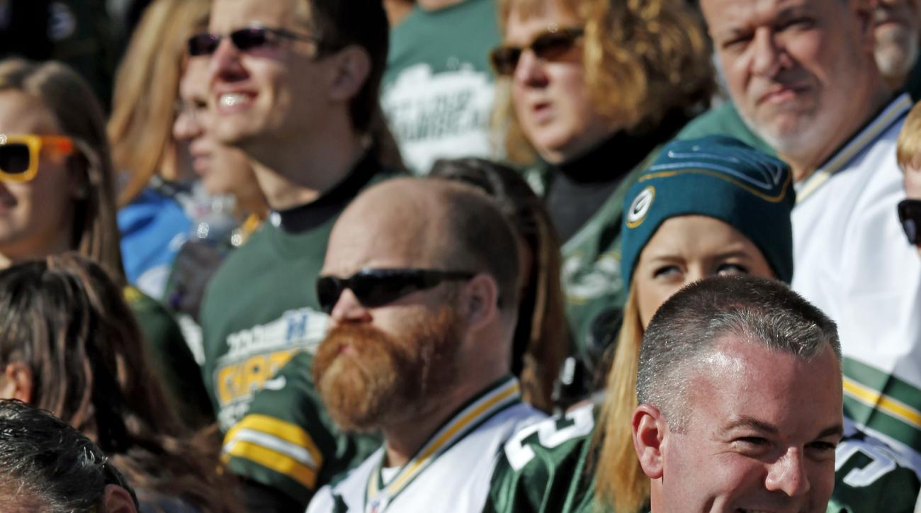 A fan shows his support for France during the first half of an NFL football game between the Green Bay Packers and the Detroit Lions Sunday, Nov. 15, 2015, in Green Bay, Wis. (AP Photo/Mike Roemer)