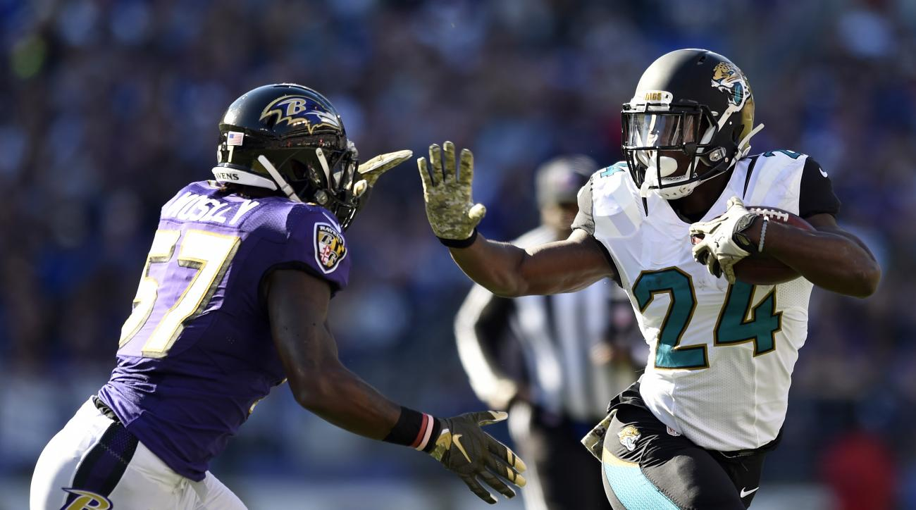 Jacksonville Jaguars running back T.J. Yeldon, right, rushes past Baltimore Ravens inside linebacker C.J. Mosley in the first half an NFL football game, Sunday, Nov. 15, 2015, in Baltimore. (AP Photo/Gail Burton)