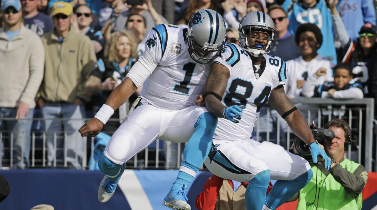 Carolina Panthers tight end Ed Dickson (84) celebrates with quarterback Cam Newton (1) after Dickson caught a 1-yard touchdown pass against the Tennessee Titans in the first half of an NFL football game Sunday, Nov. 15, 2015, in Nashville, Tenn. (AP Photo