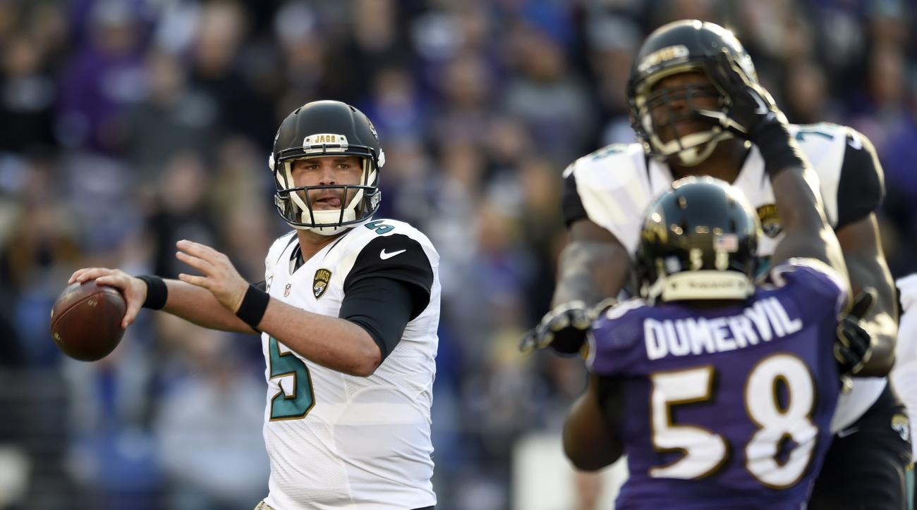 Jacksonville Jaguars quarterback Blake Bortles, left, looks to throw to a receiver as he is pressured by Baltimore Ravens outside linebacker Elvis Dumervil (58) in the first half an NFL football game, Sunday, Nov. 15, 2015, in Baltimore. (AP Photo/Gail Bu