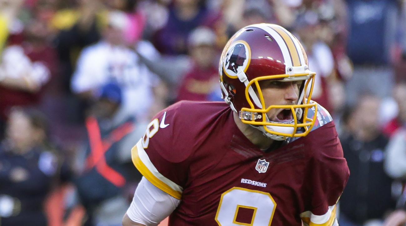 Washington Redskins quarterback Kirk Cousins (8) celebrates tight end Jordan Reed's touchdown during the second half of an NFL football game against the New Orleans Saints in Landover, Md., Sunday, Nov. 15, 2015. (AP Photo/Mark Tenally)