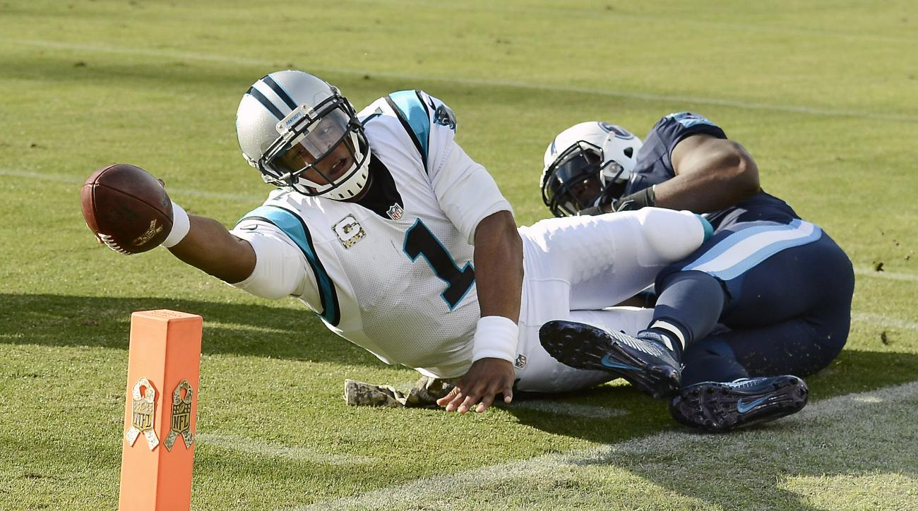 Carolina Panthers quarterback Cam Newton (1) is tackled short of the goal line by Tennessee Titans linebacker Brian Orakpo in the second half of an NFL football game Sunday, Nov. 15, 2015, in Nashville, Tenn. (AP Photo/Mark Zaleski)