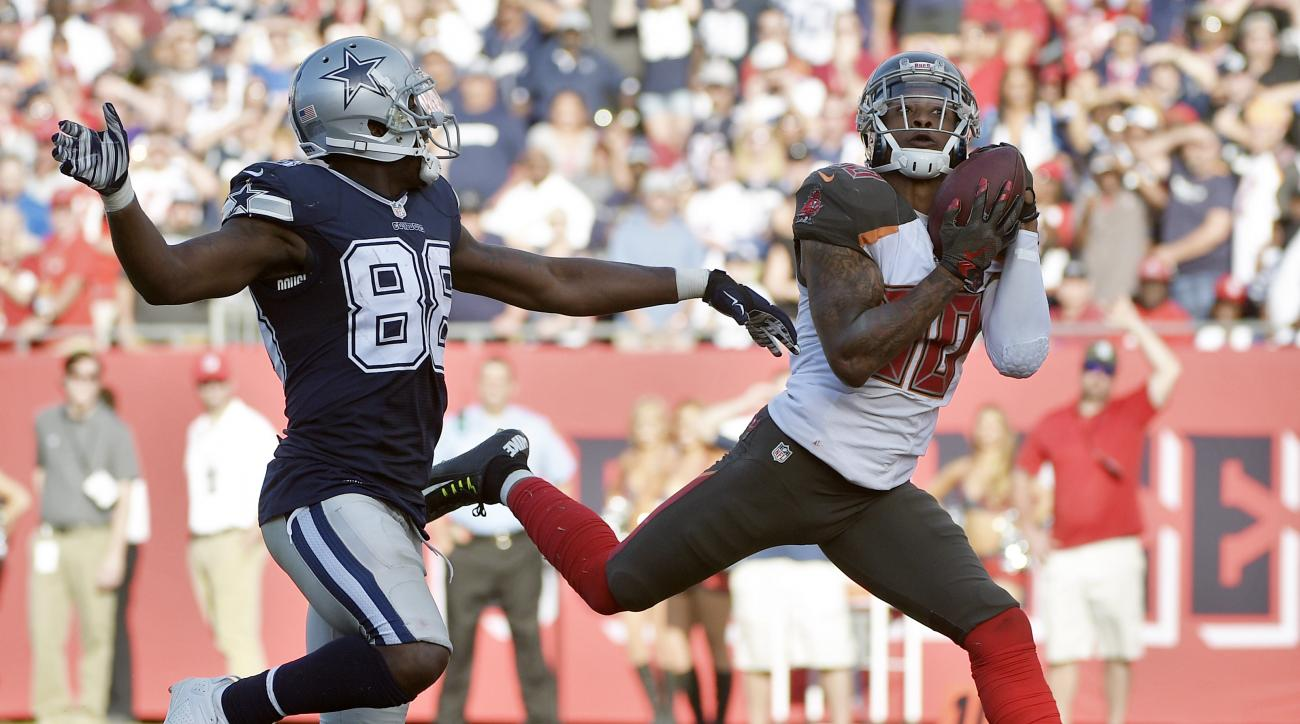 Tampa Bay Buccaneers free safety Bradley McDougald (30) intercepts a pass intended for Dallas Cowboys wide receiver Dez Bryant (88) during the fourth quarter of an NFL football game Sunday, Nov. 15, 2015, in Tampa, Fla. The Buccaneers won the game 10-6. (