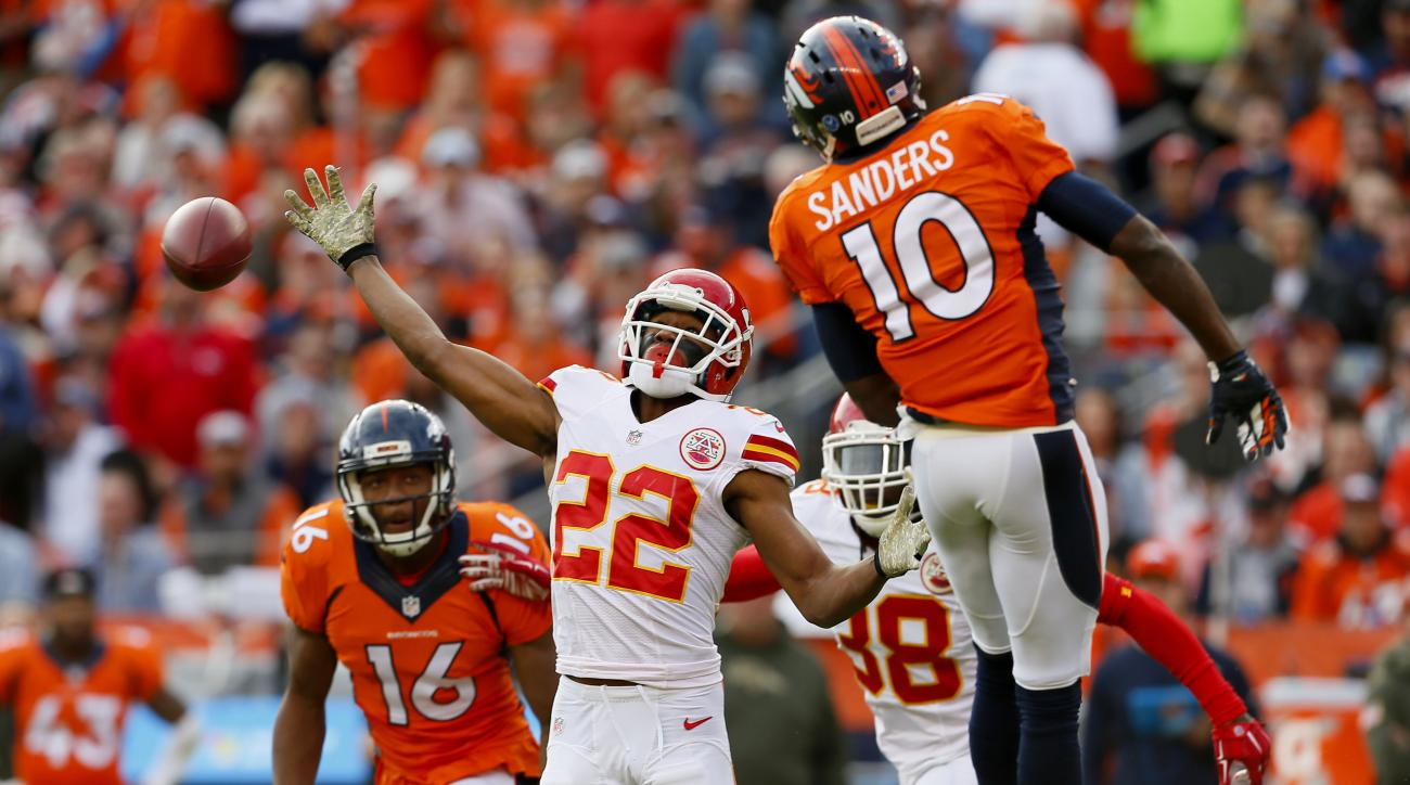 Denver Broncos wide receiver Emmanuel Sanders (10) can't handle a pass during the first half of an NFL football game as Kansas City Chiefs cornerback Marcus Peters (22) knocks the ball down, Sunday, Nov. 15, 2015, in Denver. (AP Photo/Joe Mahoney)