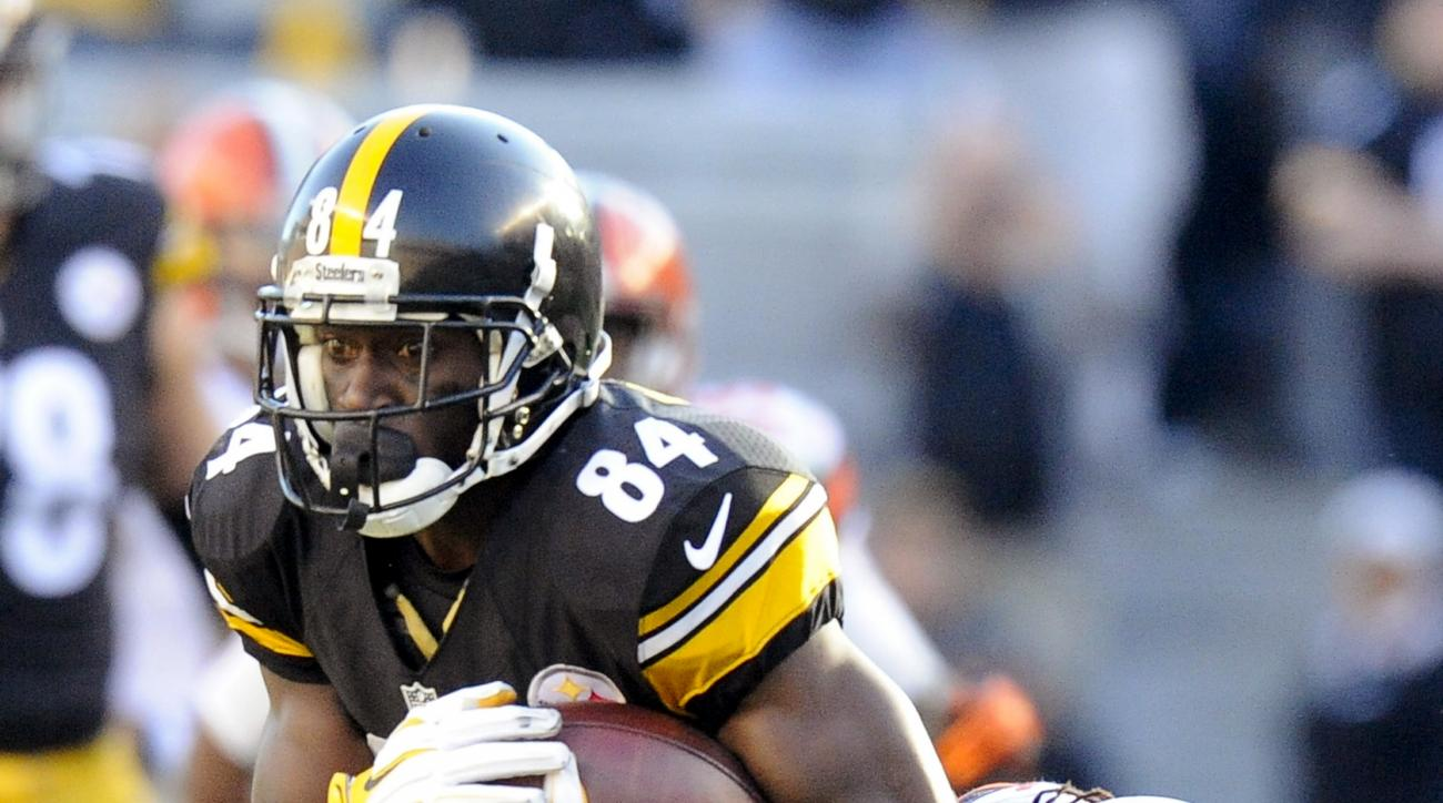 Pittsburgh Steelers wide receiver Antonio Brown (84) is tackled by Cleveland Browns cornerback Tramon Williams (22) after making a catch during the second quarter of an NFL football game Sunday, Nov. 15, 2015, in Pittsburgh. (AP Photo/Don Wright)