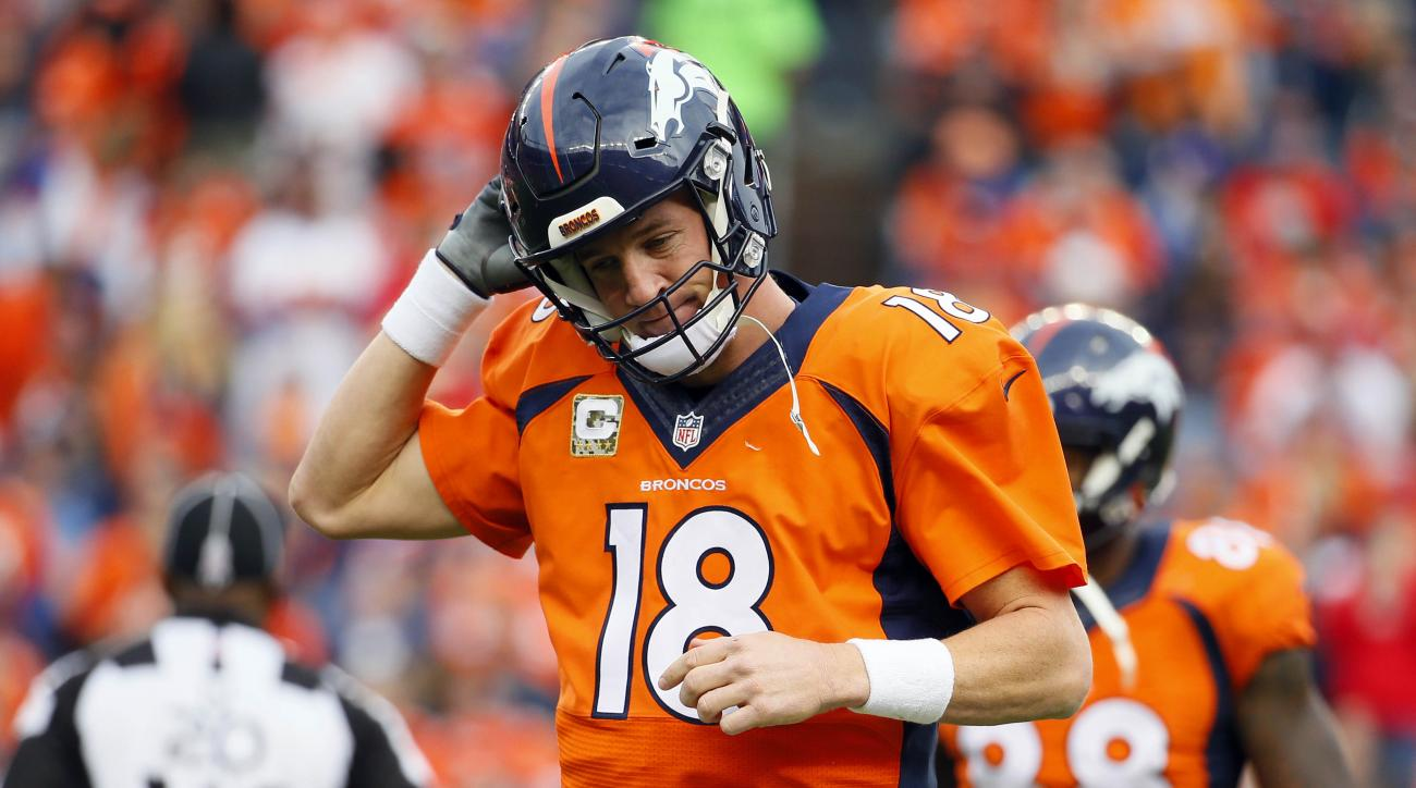 Denver Broncos quarterback Peyton Manning (18) takes off his helmet after throwing an interception during the first half of an NFL football game against the Kansas City Chiefs, Sunday, Nov. 15, 2015, in Denver. (AP Photo/Jack Dempsey)