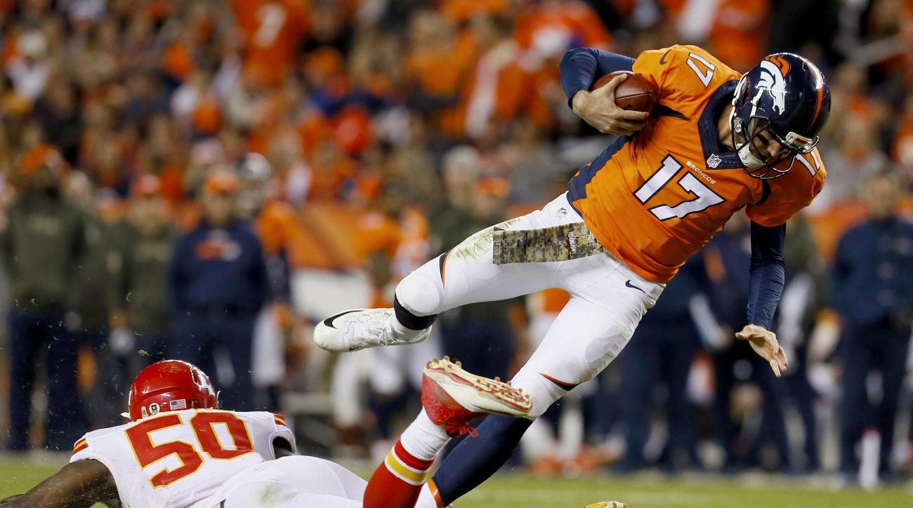 Denver Broncos quarterback Brock Osweiler (17) is tripped up by Kansas City Chiefs outside linebacker Justin Houston (50) during the second half of an NFL football game, Sunday, Nov. 15, 2015, in Denver. (AP Photo/Joe Mahoney)