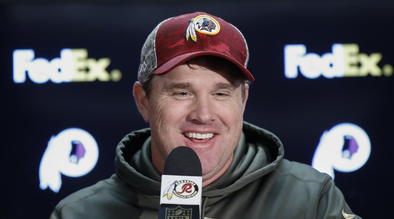 In this photo taken Nov. 15, 2015, Washington Redskins head coach Jay Gruden answers questions during the post game press conference after an NFL football game against the New Orleans Saints in Landover, Md. For the first time since 2011, the Washington R