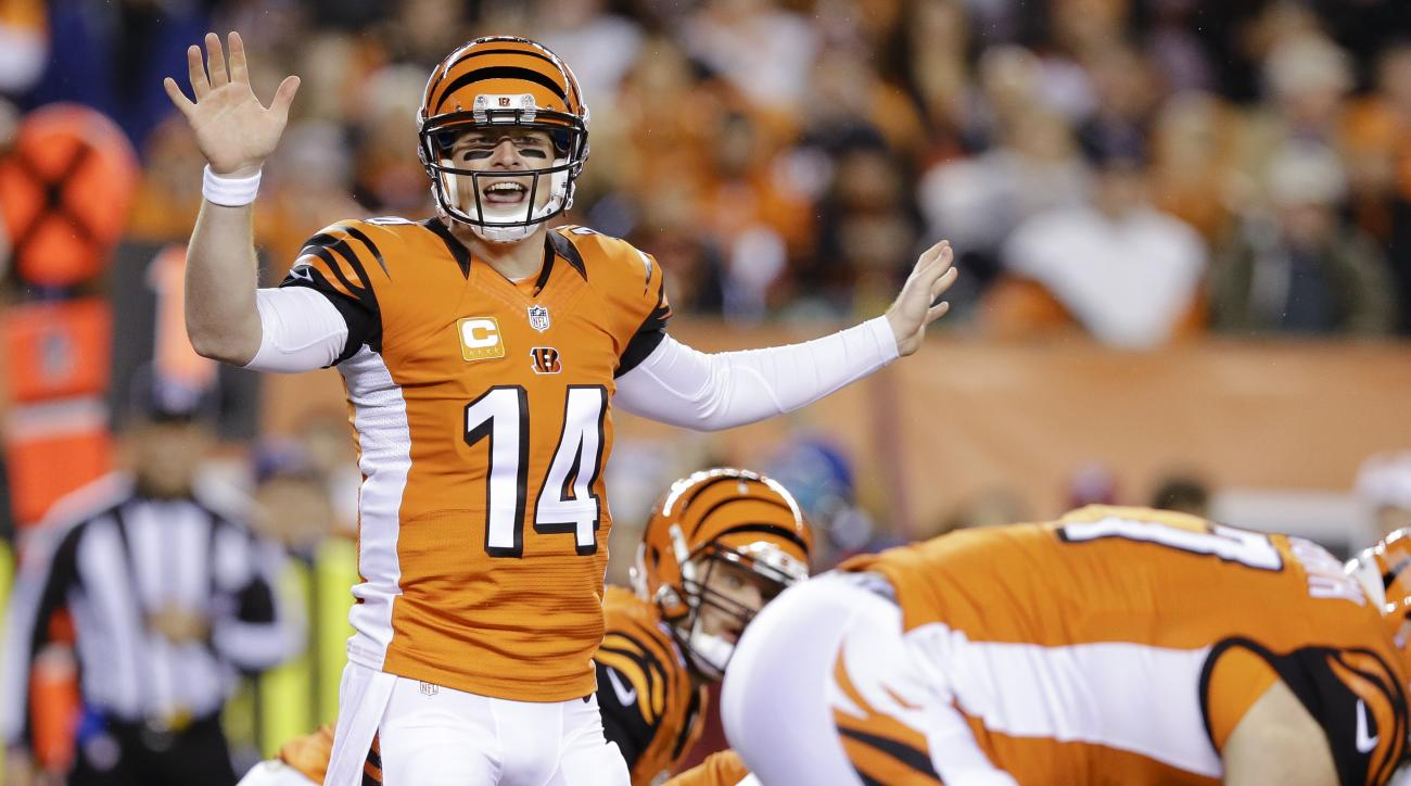 Cincinnati Bengals quarterback Andy Dalton (14) directs his players at the line of scrimmage during the first half of an NFL football game against the Houston Texans in Cincinnati, Monday, Nov. 16, 2015. (AP Photo/Michael Conroy)